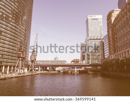 LONDON, UK - JUNE 11, 2015: The Canary Wharf business centre is the largest business district in the United Kingdom vintage