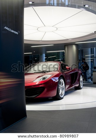 LONDON, UK - JUNE 22: The McLaren MP4-12C in the new McLaren showroom on Knightsbridge on June 22, 2011 in London, UK. The showroom was officially opened on June 21, 2011. - stock photo
