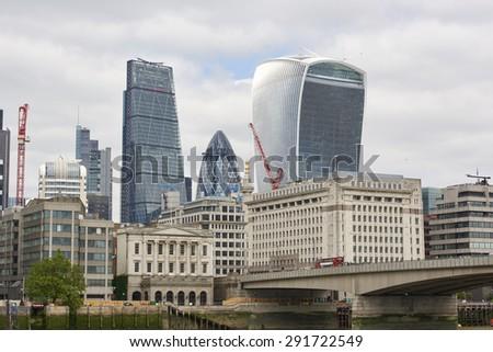 LONDON, UK - JUNE 23: The Walkie-Talkie, Cheese Grater, and Gherkin, seen from London Bridge. June 23, 2015 in London. - stock photo