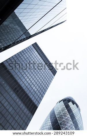 London, UK - June 20, 2015 - Three major buildings in the financial district in London, Leadenhall building, Gherkin and Aviva building towering together - stock photo