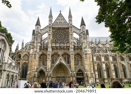 LONDON, UK- JUNE 20: Tourists and visitors gather around Westminster Abbey on June 20, 2014 in London UK - stock photo
