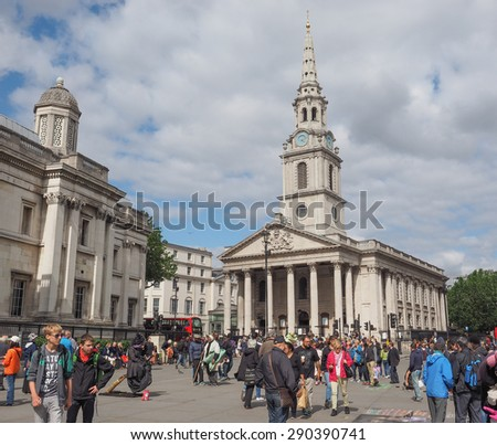 LONDON, UK - JUNE 09, 2015: Tourists in front of the Church of Saint Martin in the Fields in Trafalgar Square