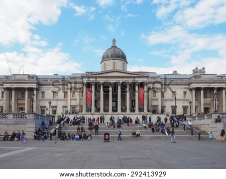 LONDON, UK - JUNE 09, 2015: Tourists visiting Trafalgar Square in front of the National Gallery - stock photo