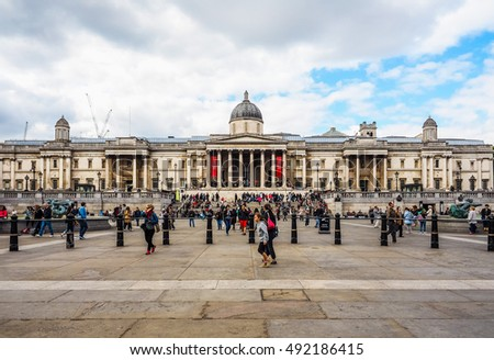 LONDON, UK - JUNE 09, 2015: Tourists visiting Trafalgar Square in front of the National Gallery (HDR)