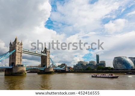 London, UK - June 15, 2016: Tower Bridge in London. The Tower Bridge spanning the river Thames is a combined bascule and suspension bridge in London built in 1886�¢â?¬â??1894 - stock photo