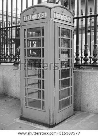 LONDON, UK - JUNE 09, 2015: Traditional red telephone box in black and white