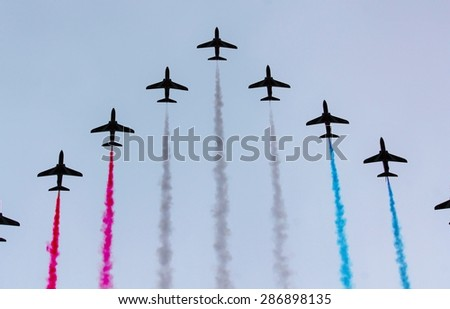 LONDON, UK - JUNE 13: Trooping the Colour ceremony, Red Arrows flyby on June 13, 2015 in London - stock photo
