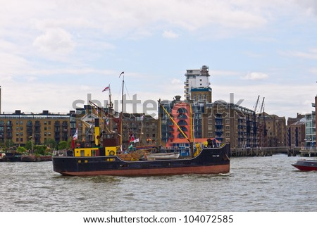 LONDON, UK-JUNE 1: Vic 56  Coastal Steamer that supplied the Navy during World war II sails for the Avenue of Sails part of the Queen's diamond Jubilee pageant, June 1, 2012 in London UK. - stock photo