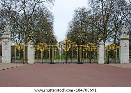 LONDON, UK - MAR 19, 2014: Canada Gate, the entrance to Green Park from Buckingham Palace.  The Gates form part of the memorial to Queen Victoria in front of the Palace. - stock photo