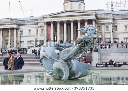 LONDON, UK - MAR 13, 2016: Fountain in Trafalgar Square in front of National Gallery representing a woman and dolphins on March 13, 2016 in London, UK.