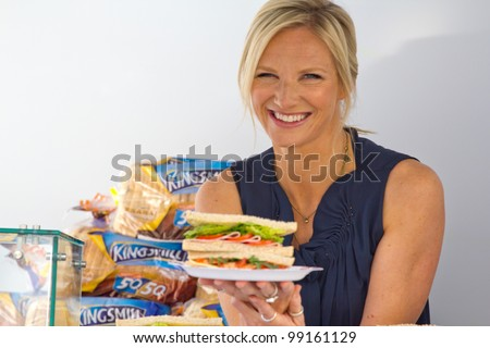 LONDON, UK - MAR. 29: Jo Whiley poses with sandwiches at the launch of a kingsmill road show in London on the Mar 29, 2012 in London, UK