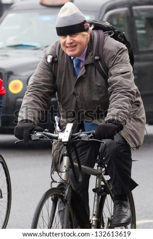 LONDON, UK - MAR 15: London Mayor Boris Johnson rides his bike in London on the MAR 15, 2013 in London, UK - stock photo