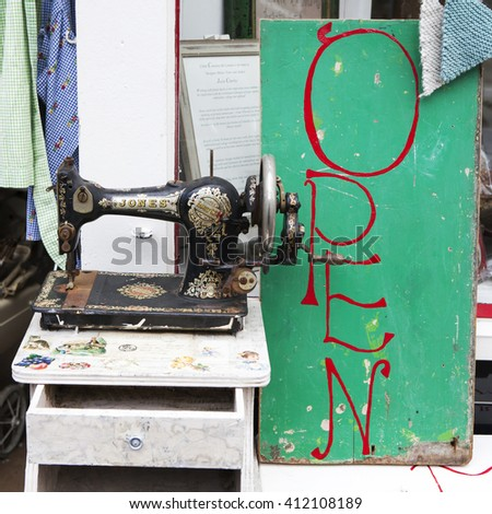 LONDON, UK - MAR 05, 2016: Old sewing Singer machine as part of a window display in an antic shop on 5th March 2016 in London, Uk. - stock photo