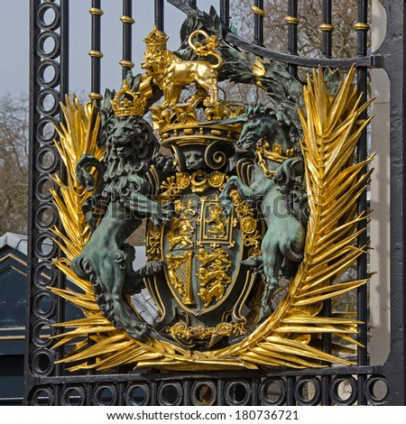 LONDON, UK - MAR 8, 2014: Royal Coat of Arms on a gate at Buckingham Palace, London. - stock photo