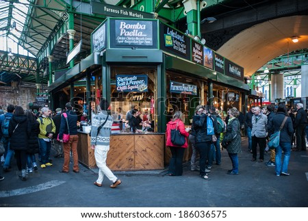 LONDON, UK - MAR 22: Unidentified people visit Borough Market in London on March 22, 2014.  - stock photo