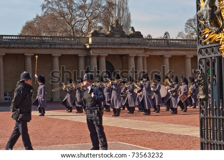 LONDON, UK - MARCH 19: Band of the Queen's Guard playing in front of Buckingham Palace during the Changing of the Guard Ceremony. March 19, 2011 in London UK. - stock photo