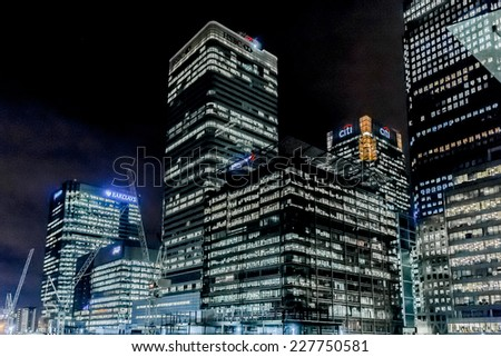 LONDON, UK - MARCH 17, 2013: Canary Wharf, located in West India Docks on Isle of Dogs - formed part of busiest port in world, is a major business district (1,300,000 sqm) in London.  - stock photo