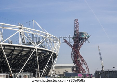 LONDON, UK -MARCH 24: Detail of London Olympics Stadium Anish Kapoor's sculpture in the background on March 24, 2012 in London. The Olympic Park is due to be ready in summer for the games. - stock photo
