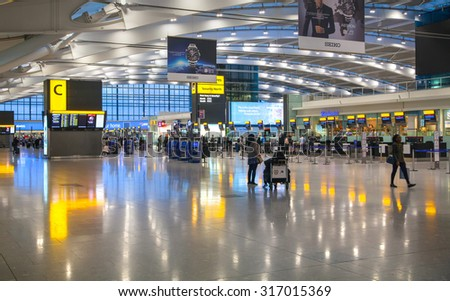 LONDON, UK - MARCH 28, 2015: Interior of departure hall Heathrow airport Terminal 5. New building - stock photo