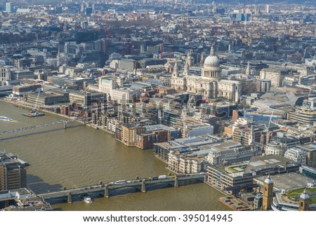 LONDON UK - MARCH 22, 2016: Panoramic aerial view of The City of London with River Thames, St. Paul's cathedral and modern office buildings in London