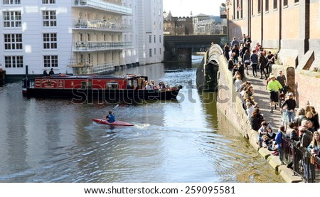 LONDON, UK-MARCH 07, 2015: People enjoy day out  in Camden Town, London. Famous tourists destination which attract tens thousands people every day offering food, shops, sightseeing by boat, walk... - stock photo
