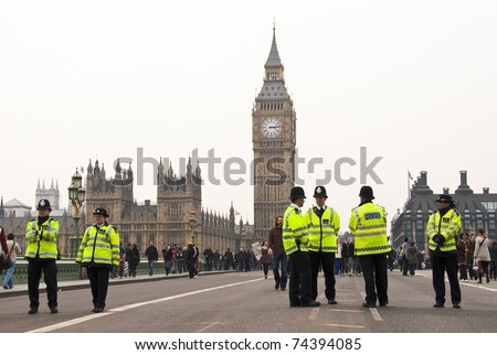 LONDON, UK - MARCH 26: Police officers during the march in central London against public spending cuts, March 26, 2011 in London, United Kingdom - stock photo