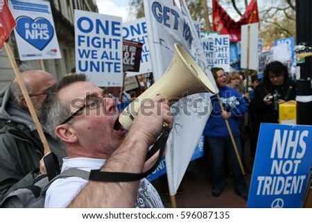London, UK - March 4, 2017: Protesters march through central London during a demonstration in support of the NHS. Thousands protested against NHS spending cuts, hospital closures and privatisation.