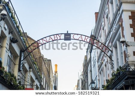 LONDON, UK - MARCH 01: Traditional Carnaby street street sign arch. The street is famous for its fashion stores. March 01, 2014 in London. - stock photo