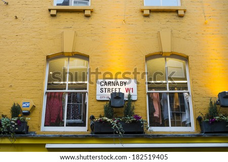 LONDON, UK - MARCH 01: Traditional Carnaby street street sign. The street is famous for its fashion stores. March 01, 2014 in London. - stock photo