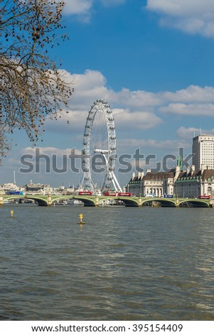 LONDON UK - MARCH 22, 2016:View of London Eye over Lambeth Bridge across River Thames. It is the most popular paid tourist attraction in the UK with over 3.75 million visitors annually