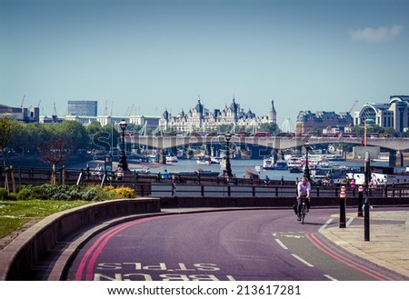 LONDON, UK - MAY 17, 2014: A view of London from the Blackfriars Station area, with the Royal Courts of Justice building seen in the background. - stock photo