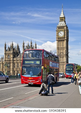LONDON, UK - MAY 14, 2014: Big Ben and houses of Parliament on the river Thames, London UK - stock photo