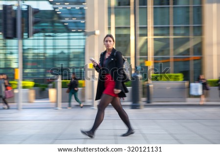 LONDON, UK - MAY 21, 2015:  Blur of Business people walking on street after working day. Canary Wharf - stock photo