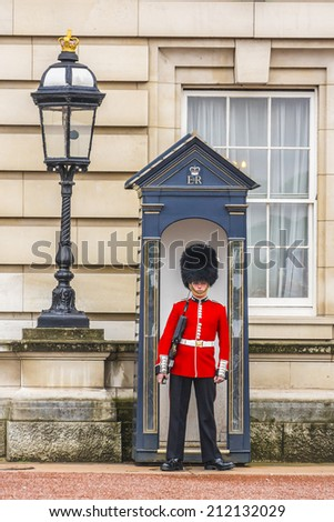 LONDON, UK - MAY 30, 2013: Buckingham Palace in London, England. Built in 1705, the Palace is the official London residence and principal workplace of the British monarch. Guard.