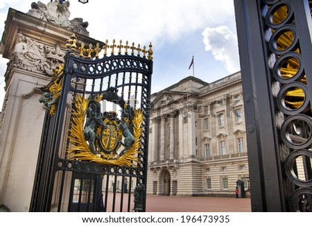 LONDON, UK - MAY 14, 2014: Buckingham Palace the official residence of Queen Elizabeth II and one of the major tourist destinations U.K. Entrance and main gate with lanterns   - stock photo