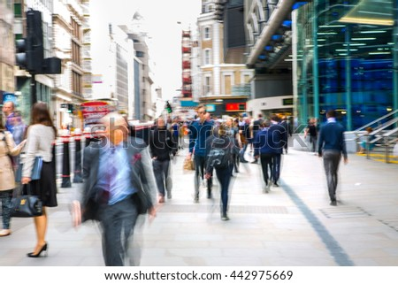 LONDON, UK - MAY 17, 2016: Business people walk through the City of London street. Blurred image. City of London business life concept  - stock photo