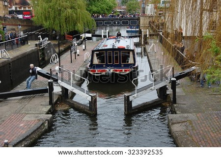 LONDON, UK - MAY 11: Camden Lock is a twin manually operated lock on the Regent's Canal in Camden Town on May 11, 2013 in London, UK. - stock photo