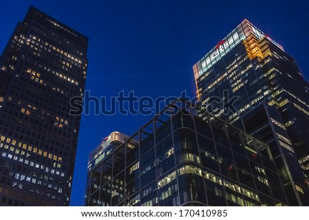 LONDON, UK - MAY 26, 2013: Canary Wharf at night. Canary Wharf is a major business district located in Borough of Tower Hamlets, contains many of UK tallest skyscrapers - stock photo