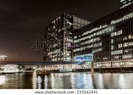 LONDON, UK - MAY 26, 2013: Canary Wharf at night. Canary Wharf is a major business district located in Borough of Tower Hamlets, contains many of UK tallest skyscrapers. - stock photo