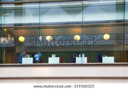 LONDON, UK - MAY 5, 2015: Canary Wharf banking and business centre, cafe. Office workers having lunch