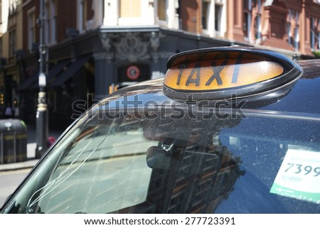 LONDON, UK - MAY 13: Detail famous black cab in street on sunny day. May 13, 2015 in London. - stock photo