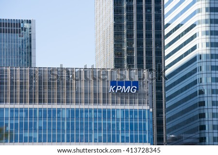 LONDON, UK - MAY 1, 2016: Detail shot of Canary Wharf KPMG skyscraper against blue sky. Canary Wharf is London's second financial district. - stock photo