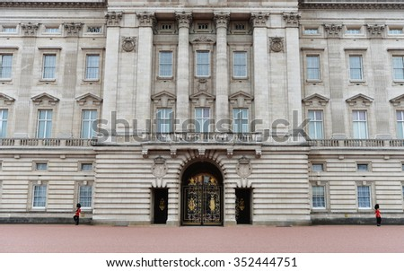 LONDON, UK - MAY 30, 2015: Exterior View of Buckingham Palace. The palace has served as the official residence of Britain's sovereigns since 1837, and a venue for royal ceremonies and state visits. - stock photo