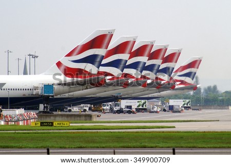 LONDON, UK - MAY 19, 2012: Fleet of Boeings 747 of British Airways standing on the apron of London Heathrow airport. - stock photo
