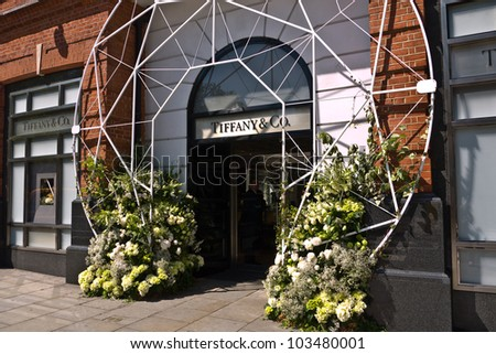 LONDON, UK-MAY 25: Floral displays surround the entrance to Tiffany's part of the Chelsea in Bloom competition, judged by the Royal Horticultural Society. May 25, 2012 in London UK. - stock photo