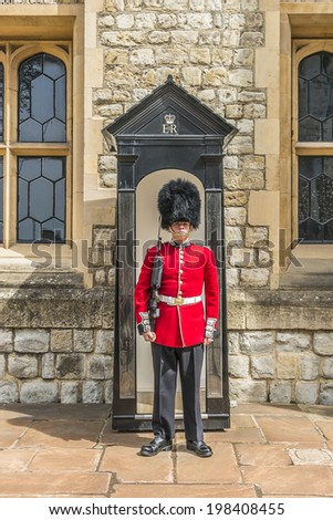 LONDON, UK - MAY 26, 2013: Guard in Castle Tower of London. British Guards in red uniforms are among the most famous in the world.