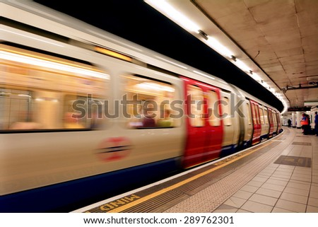 LONDON, UK - MAY 12 2015:London Underground train.The average scheduled train speed (including stops) is 33 km/h. - stock photo