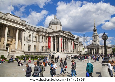 LONDON, UK - MAY 14, 2014 National Gallery and Trafalgar Square with lots of tourists  - stock photo