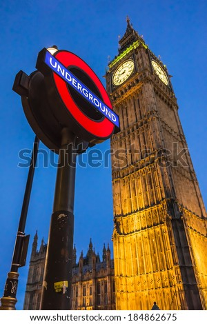 LONDON, UK - MAY 31, 2013: Night view of London Underground subway sign in front of famous Clock Tower (now officially called the Elizabeth Tower) with bell Big Ben at Westminster in London.