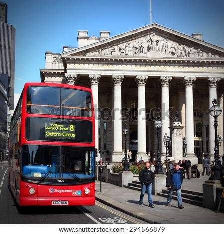 LONDON, UK - MAY 15, 2012: People ride London Bus in London. As of 2012, LB serves 19,000 bus stops with a fleet of 8000 buses. On a weekday 6 million rides are served. - stock photo